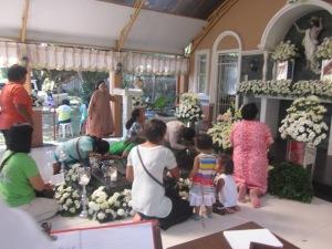 Pilgrims praying at the Tomb