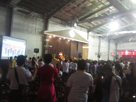 "The participants practicing the actions of the song ""Christ in Us, Our Hope of Glory"""