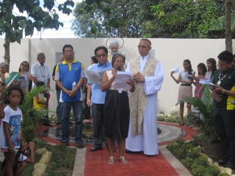 Bishop Palma leading the prayer